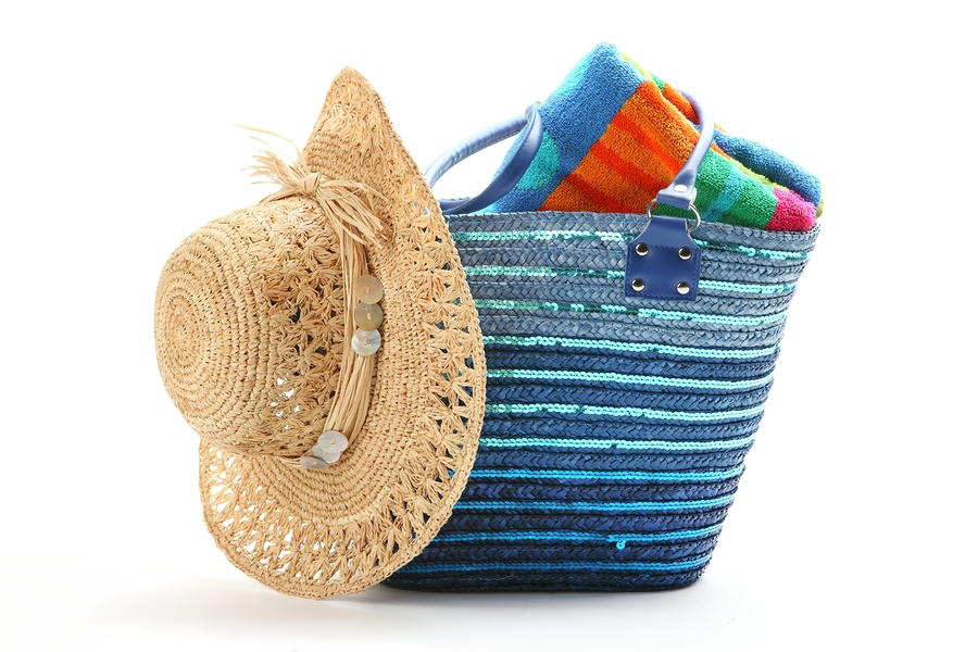 bigstock-Beach-bag-with-straw-hat-and-t-27368654